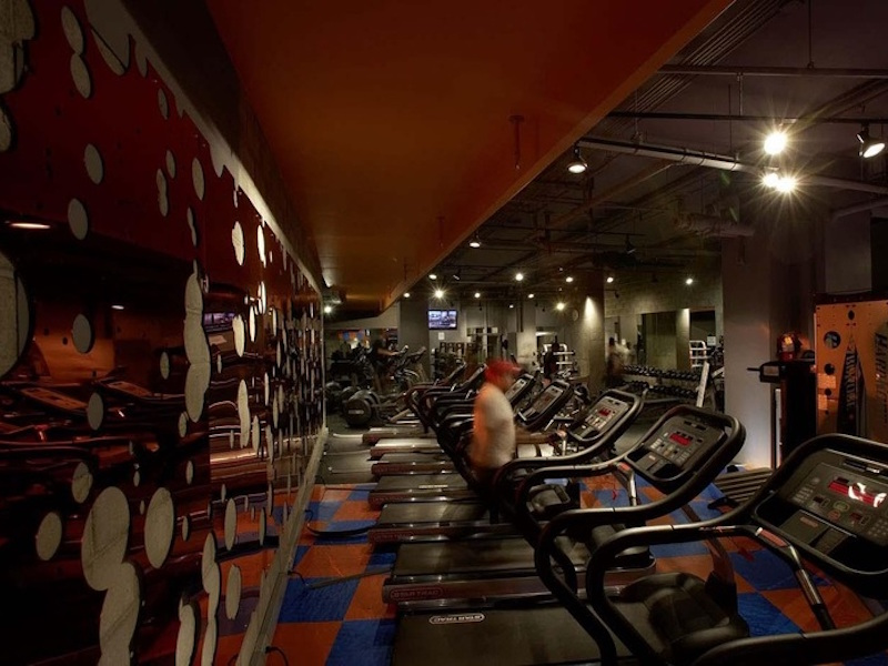 We wanted to convey a grand presence within the available space of this gym; and by using the circular cut out mirror to open up the block wall and reflect light, we accomplished our mission on this project.
